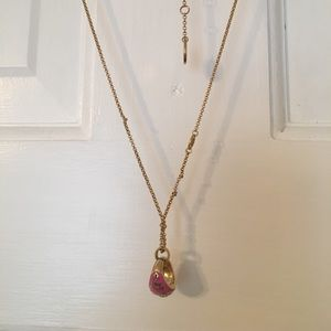 Juicy Couture class ring necklace.